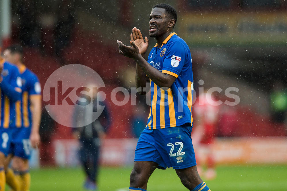 Aristotle Nsiala  thanks the travelling supporters at the end of the EFL Sky Bet League 1 match between Walsall and Shrewsbury Town at the Banks's Stadium, Walsall, England on 7 October 2017. Photo by Darren Musgrove.