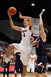 November 18, 2010; Stanford, CA, USA;  Stanford Cardinal forward Stefan Nastic (4) shoots past Virginia Cavaliers forward Will Sherrill (22) during the first half at Maples Pavilion.