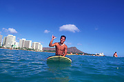 Man on surfboard, Waikiki, Oahu, Hawaii (editorial use only-not mdole released)<br />