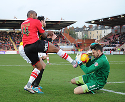 Northampton's Matthew Duke stops the ball from Exeter City's Clinton Morrison - Photo mandatory by-line: Alex James/JMP - Mobile: 07966 386802 - 10/01/2015 - SPORT - football - Exeter - St James Park - Exeter City v Northampton - Sky Bet League Two