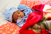 A sleeping baby on the NICU (Neonatal Intensive Care Unit) Ward. St Walburg's Hospital, Nyangao. Lindi Region, Tanzania.