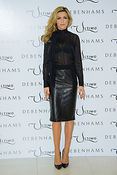 Abbey Clancy pose's for Ultimo Photocall. London, United Kingdom. Tuesday, 11th February 2014. Picture by Chris Joseph / i-Images