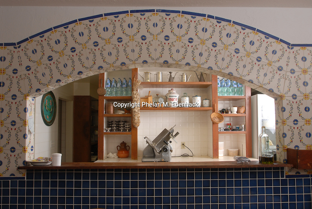 Italian tile frames the opening to a country-style kitchen in Orlando, Florida.