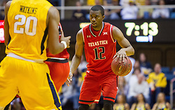 Feb 18, 2017; Morgantown, WV, USA; Texas Tech Red Raiders guard Keenan Evans (12) dribbles the ball during the first half against the West Virginia Mountaineers at WVU Coliseum. Mandatory Credit: Ben Queen-USA TODAY Sports