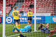 Manuela Zinsberger (GK) (Arsenal) saves the ball and looks across at Lea Le Garrec (Brighton & Hove) who fell into the goal during the FA Women's Super League match between Brighton and Hove Albion Women and Arsenal Women FC at The People's Pension Stadium, Crawley, England on 12 January 2020.