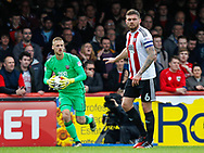 Daniel Bentley of Brentford and Harlee Dean of Brentford during the Sky Bet Championship match between Brentford and Bristol City at Griffin Park, London<br /> Picture by Mark D Fuller/Focus Images Ltd +44 7774 216216<br /> 01/04/2017