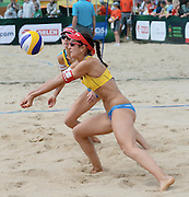 STARE JABLONKI POLAND - July 1:   Romana Kayser /1/ and Muriel Graessli /2/ of Switzerland in action during Day 1 of the FIVB Beach Volleyball World Championships on July 1, 2013 in Stare Jablonki Poland.  (Photo by Piotr Hawalej)
