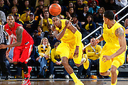 ANN ARBOR, MI - FEBRUARY 5: Glenn Robinson III #1 of the Michigan Wolverines passes The Rock to Trey Burke #3 on a fast break against the Ohio State Buckeyes during the game at Crisler Center in Ann Arbor, Michigan on February 5. Michigan won 76-74. (Photo by Joe Robbins)