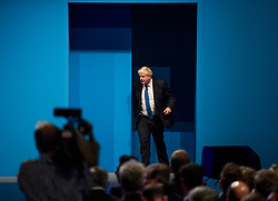 © Licensed to London News Pictures. 03/10/2017. Manchester, UK. British foreign secretary BORIS JOHNSON arrives on stage to deliver his keynote speech on day three of the Conservative Party Conference. The four day event is expected to focus heavily on Brexit, with the British prime minister hoping to dampen rumours of a leadership challenge. Photo credit: Ben Cawthra/LNP