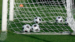 A generic picture of Adidas football's in a goal.