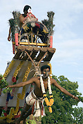 Penitents at the festival hang themselves from hooks and are suspended in mid air from a raised platform on a tractor. ..2004