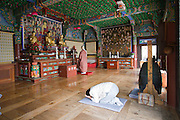 Dadohae Marine National Park. Dolsan-do. Hyang-ram (Hyang-il-am) buddhist hermitage. Monk and visitors praying.