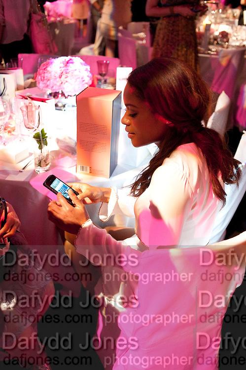 NAOMIE HARRIS, Glamour Women of the Year Awards 2011. Berkeley Sq. London. 9 June 2011.<br /> <br />  , -DO NOT ARCHIVE-© Copyright Photograph by Dafydd Jones. 248 Clapham Rd. London SW9 0PZ. Tel 0207 820 0771. www.dafjones.com.