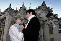 Stock photo of a Romantic young couple meeting under the House with Chimeras in Kiev which was built by Vladislav Gorodetskiy in 1901-1903 for his family and has many legends connected to it This is one of the architectural landmarks in Kyiv Ukraine
