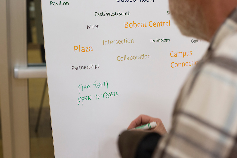 Tim Traxler, a long-time Athens resident, writes what comes to his mind when he thinks about Park Place during the Park Place public planning workshop at the Athens Community Center on Feb. 22, 2017.