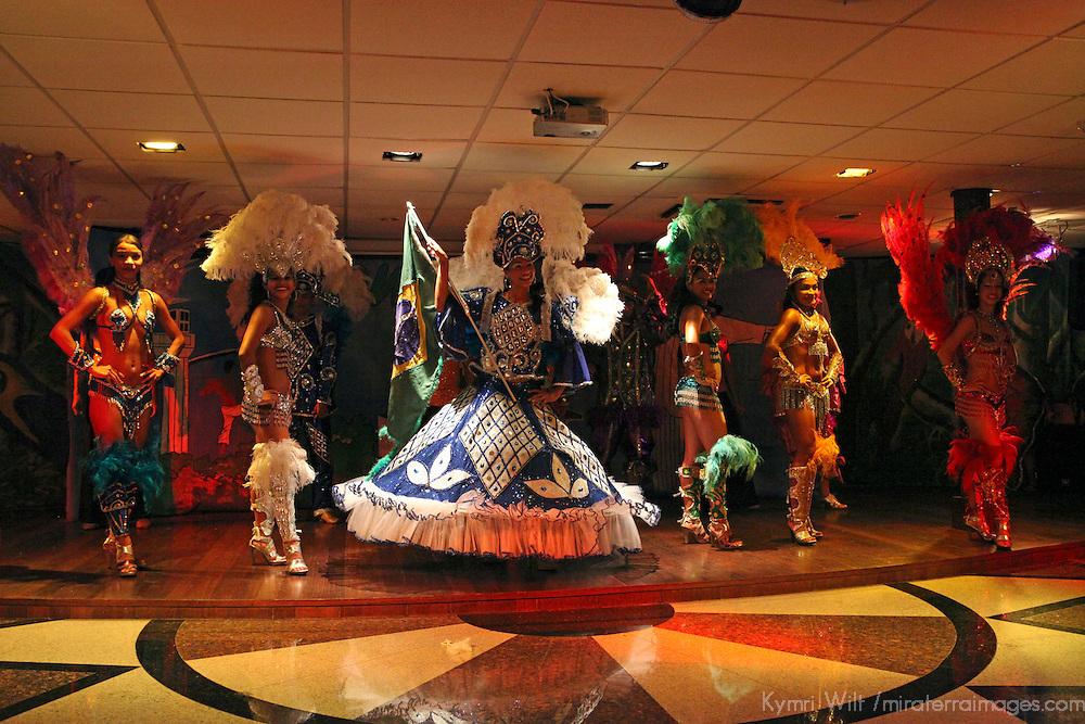 South America, Brazil, Manaus. Dancing entertainment aboard the Iberostar Grand Amazon.