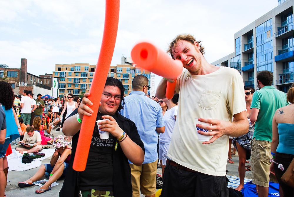 Concert goers appropriately provide their own pool noodles for the JELLY Pool Party free concert series at East River State Park, Williamsburg, Brooklyn, New York