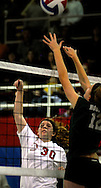 10 DEC. 2010 -- ST. LOUIS -- Assumption School volleyball player Kristina Eason (30) spikes the ball past Holy Infant School player Morgan Gresham (12) during the championship match of the CYC girls' parochial closed division tournament at the Monsignor Meyer Youth Center in St. Louis Friday Dec. 10, 2010. Image © copyright 2010 Sid Hastings.