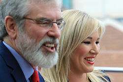 © Licensed to London News Pictures. 6/02/2016. Belfast, Northern Ireland, UK. Sinn Fein's leader in the North of Ireland Michelle O'Neill and Party President Gerry Adams laughs during the Launch of their Candicates for the forth coming elections in Northern Ireland. The fallout from the RHI scandal surrounding the scheme, which is approximately £490m over budget, resulted in the resignation of Sinn Fein's deputy first minister, Martin McGuinness, the collapse of Stormont's institutions and the calling of snap elections on 2 March.  Photo credit : Paul McErlane/LNP