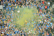 AFC Wimbledon fans cet off a smoke bomb after the final whistle to celebrate promotion with a win over Plymouth in the Sky Bet League 2 play off final match between AFC Wimbledon and Plymouth Argyle at Wembley Stadium, London, England on 30 May 2016. Photo by Graham Hunt.
