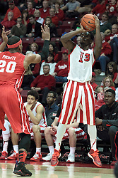 15 February 2014: Daishon Knight pumps off a there point shot ahead of Tyshon Pickett during an NCAA Missouri Valley Conference (MVC) mens basketball game between the Bradley Braves and the Illinois State Redbirds  in Redbird Arena, Normal IL.