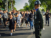 14 OCTOBER 2016 - BANGKOK, THAILAND:  People going into the Grand Palace to pay respects to Bhumibol Adulyadej, the King of Thailand, walk past Thai soldiers in front of the palace. The King died Oct. 13, 2016. He was 88. His death comes after a period of failing health. With the king's death, the world's longest-reigning monarch is Queen Elizabeth II, who ascended to the British throne in 1952. Bhumibol Adulyadej, was born in Cambridge, MA, on 5 December 1927. He was the ninth monarch of Thailand from the Chakri Dynasty and is known as Rama IX. He became King on June 9, 1946 and served as King of Thailand for 70 years, 126 days. He was, at the time of his death, the world's longest-serving head of state and the longest-reigning monarch in Thai history.    PHOTO BY JACK KURTZ