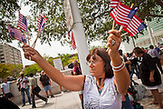 22 JULY 2010 -- PHOENIX, AZ: Edith dePew (CQ dePew) from Phoenix, waved American flags in support of 1070. Hundreds of people came to the Sandra Day O'Connor United States Courthouse (CQ) in downtown Phoenix Thursday. PHOTO BY JACK KURTZ