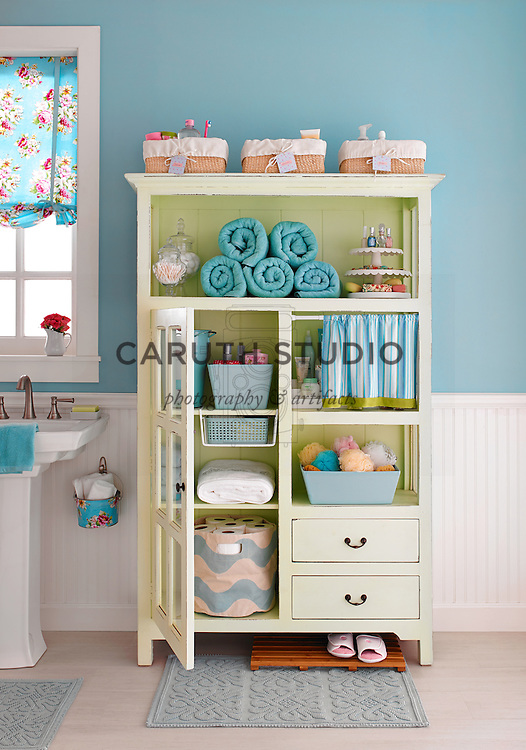 Organized bathroom cabinet in fresh colors