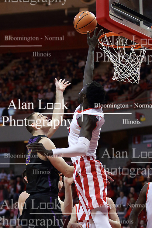 """17 February 2018:  Daouda """"David"""" Ndiaye gets his hand between the hoop and a shot offered up by Ted Friedman during a College mens basketball game between the University of Northern Iowa Panthers and Illinois State Redbirds in Redbird Arena, Normal IL"""