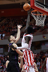 "17 February 2018:  Daouda ""David"" Ndiaye gets his hand between the hoop and a shot offered up by Ted Friedman during a College mens basketball game between the University of Northern Iowa Panthers and Illinois State Redbirds in Redbird Arena, Normal IL"