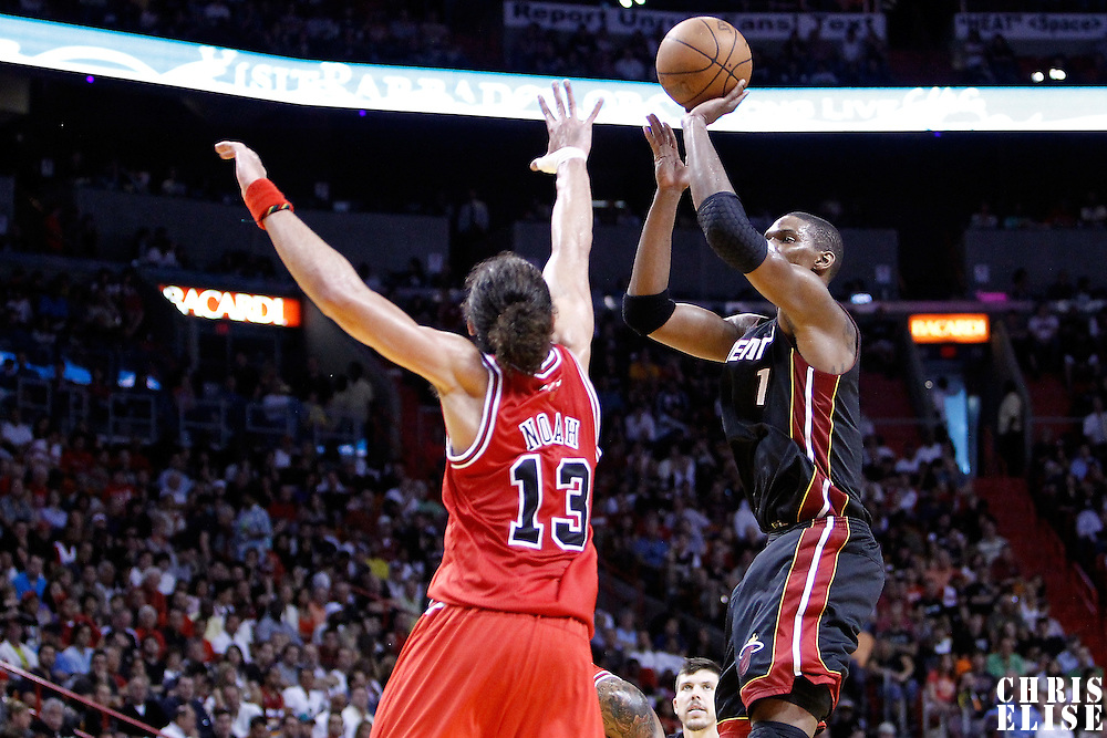 06 March 2011: Miami Heat power forward Chris Bosh (1) takes a jumpshot over Chicago Bulls center Joakim Noah (13) during the Chicago Bulls 87-86 victory over the Miami Heat at the AmericanAirlines Arena, Miami, Florida, USA.