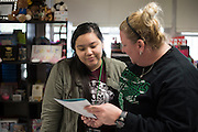 Genesis Morales and her teacher, Krystal Morrow, chat during class at Bryan Adams High School on March 24, 2016 in Dallas, Texas. (Cooper Neill for The Texas Tribune)
