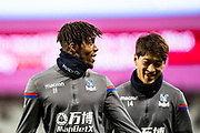 Crystal Palace #11 Wilfried Zaha, Crystal Palace #14 Lee Chung-yong, warms up ahead of the Premier League match between West Ham United and Crystal Palace at the London Stadium, London, England on 30 January 2018. Photo by Sebastian Frej.