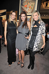 Left to right, ANNITA NATHANAIL, MADA PAPADAKOS and OLGA GERAKIDU at a party to celebrate the publication of Elena Makri Liberis's book 'Every Month, Same day' held at Sotheby's, 34-35 New Bond Street, London on 5th May 2009.