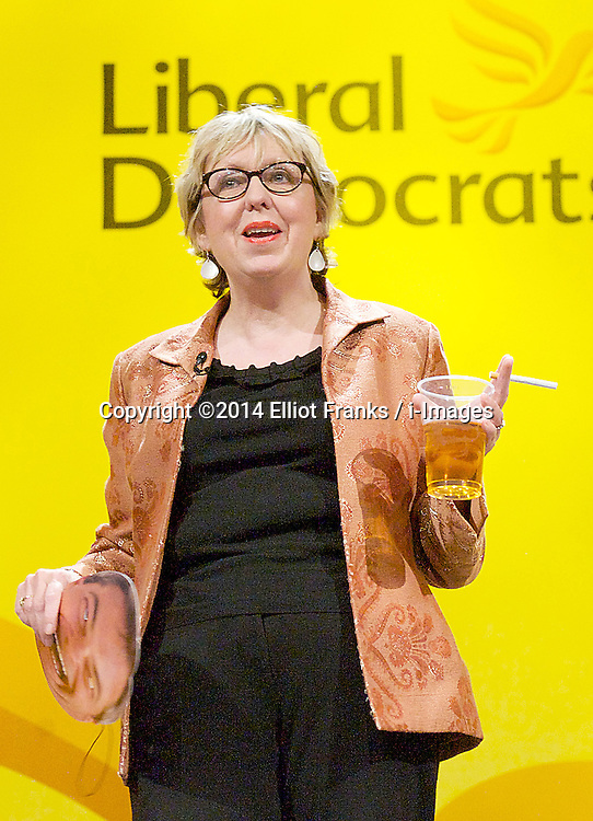 Lorely Burt MP dressed as Nigel Farage as she introduces Liberal Democrat leader Nick Clegg at the party's Spring conference in York, United Kingdom. Sunday, 9th March 2014. Picture by Elliot Franks / i-Images