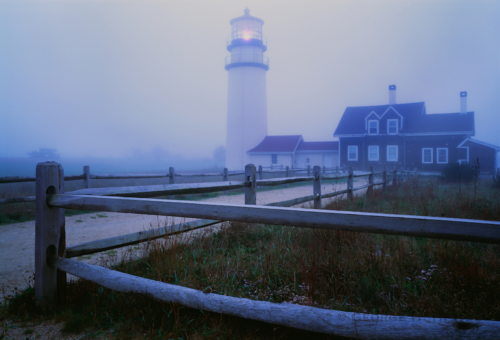 1000-1003~ Copyright: George H. H. Huey ~ Cape Cod Lighthouse [also known as Highland Light] in fog.  [First lighthouse constructed here in 1798, this one dates to 1857] . Cape Cod National Seashore, Massachusetts.