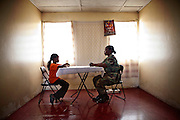 Dean Venus, Executive officer at the Coast Guard is seen in her house. She is the first female coast guard of Liberia, 29 July, 2010.