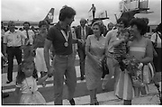 1983-15-08.15th August 1983.15-08-1983.08-15-83..Photographed at Dublin Airport..A Family matter:..Gold medalist Eamonn Coughlan geeeted by press and supporters on the tarmac of Dublin Airport on his return from the World Athletic Championships in Finland. His wife Yvonne and chldren Suzanne (four) and Eamonn Jn (two) are with him. Suzanne is in his arms while his wife holds Eamonn Jn. His mother Kathleen walks with the family. .
