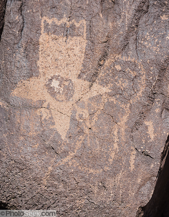 Ancestral Puebloan people chipped various figures into the desert varnish (oxidized surface) of 200,000-year-old volcanic basalt rock, here on the Cliff Base Trail, in Boca Negra Canyon, in Petroglyph National Monument, Albuquerque, New Mexico, USA.  Archeologists estimate the 23,000 petroglyphs in the monument were created between 1000 BC and AD 1700.