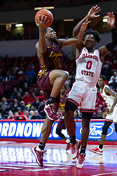 NORMAL, IL - January 19: Marquise Kennedy looks past DJ Horne at the goal during a college basketball game between the ISU Redbirds and the Loyola University Chicago Ramblers on January 19 2020 at Redbird Arena in Normal, IL. (Photo by Alan Look)