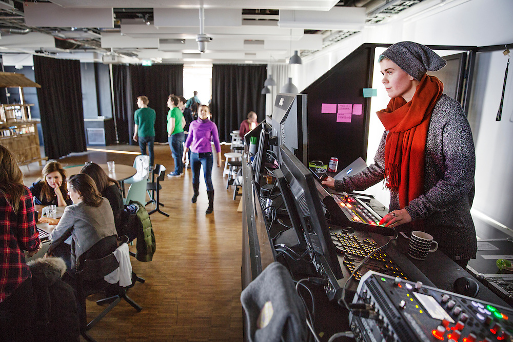 """2016-02-15, Inside Spotify's Stockholm HQ, Sweden. The top floor hosts a small """"concert hall"""" with a Disc-jockey stand, disco lights and a stage. Sara Fritzon hand out the music to the working audience."""