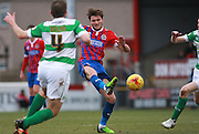 Dagenham striker Oliver Muldoon passes forward under pressure during the Sky Bet League 2 match between Dagenham and Redbridge and Yeovil Town at the London Borough of Barking and Dagenham Stadium, London, England on 27 February 2016. Photo by Bennett Dean.