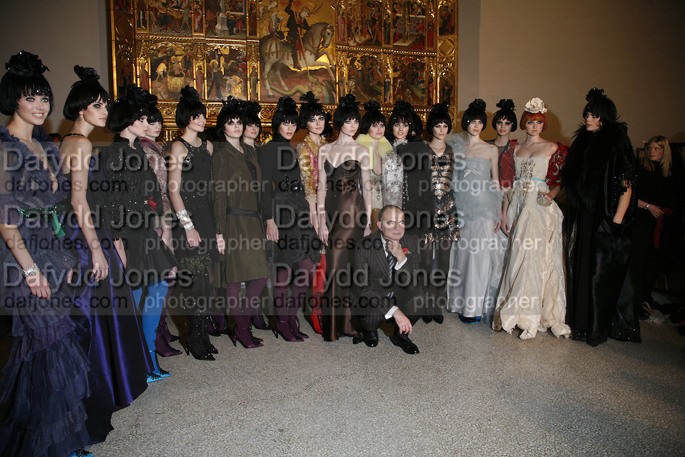 Christian Lacroix with the models, Party to celebrate the Christian Lacroix Fashion in Motion fashion show and the opening of  	M/M Paris: Antigone Under Hypnosis part of  Paris Calling the UK-wide celebration of contemporary French culture. V. & A. London. 31 October 2006. -DO NOT ARCHIVE-© Copyright Photograph by Dafydd Jones 66 Stockwell Park Rd. London SW9 0DA Tel 020 7733 0108 www.dafjones.com