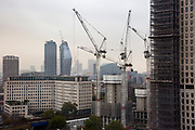 Tower cranes on a construction site adjacent to the Shell building on Stamford Street, South Bank, London SE1.  (photo by Andrew Aitchison / In pictures via Getty Images)