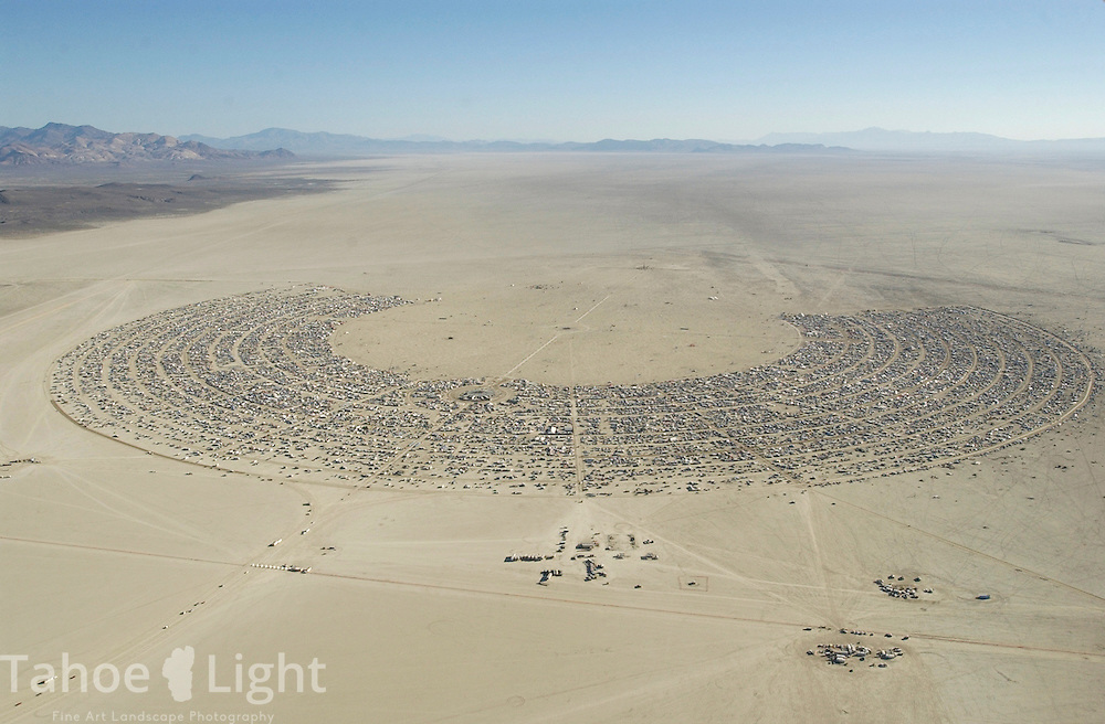The Black Rock City, Nevada's seventh largest city for the time it is in place during the Burning Man celebration in the  Black Rock Desert 100 miles north east of Reno, NV, is seen from the air on its final day Sunday, 2004. Berk Snow, a pilot from Laytonville, CA flew in for his first burn and like many of the more than 70 planes at the event, was happy to take all sightseers who ventured out to the landing strip up for a quick look.