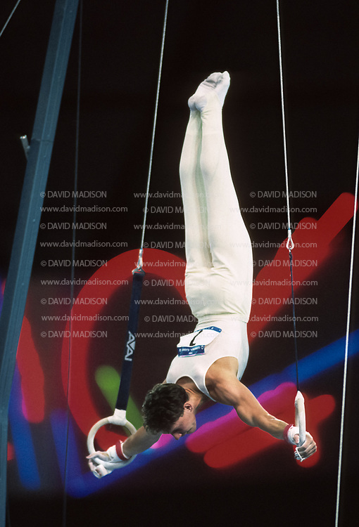 SEATTLE - JULY 1990:  Szilveszter Csollany of Hungary performs on the still rings during the gymnastics competition of the 1990 Goodwill Games held from July 20 - August 5, 1990.  The gymnastics venue was the Tacoma Dome in Tacoma, Washington.  (Photo by David Madison/Getty Images)