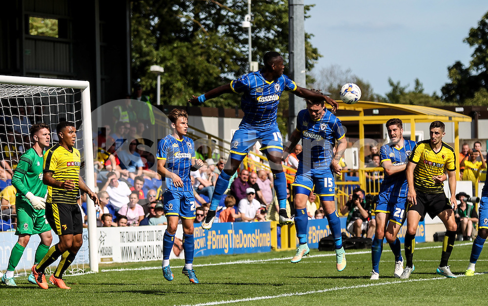 George Oakley of AFC Wimbledon clears his lines during the Pre-season Friendly match between AFC Wimbledon and Watford at the Cherry Red Records Stadium, Kingston, England on 11 July 2015. Photo by Ken Sparks.