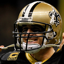 January 1, 2012; New Orleans, LA, USA; New Orleans Saints quarterback Drew Brees (9) reacts after throwing a touchdown pass against the Carolina Panthers during the second quarter of a game at the Mercedes-Benz Superdome. Mandatory Credit: Derick E. Hingle-US PRESSWIRE
