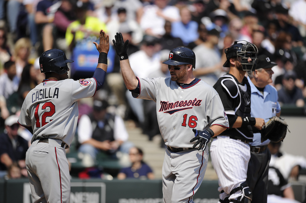 CHICAGO - APRIL 10:  Jason Kubel #16 of the Minnesota Twins celebrates with teammates after hitting a home run against the Chicago White Sox on April 10, 2010 at U.S. Cellular Field in Chicago, Illinois.  The Twins defeated the White Sox 2-1.  (Photo by Ron Vesely)