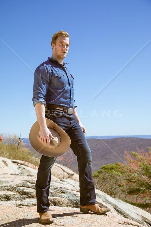cowboy on a mountain top